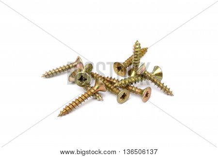 Pile of  wood screws isolated on white background