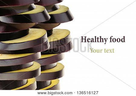 Pile of slices of eggplant on a white background. Fresh raw sliced eggplant. Isolated. Decorative frame border. Food background.