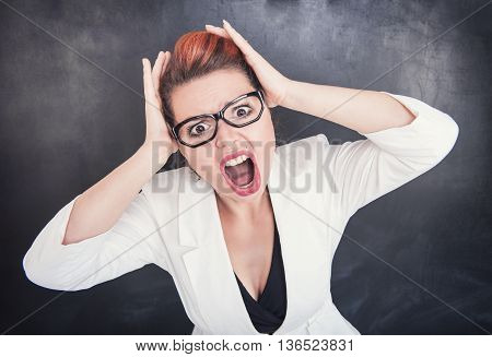 Angry Screaming Teacher On Blackboard Background