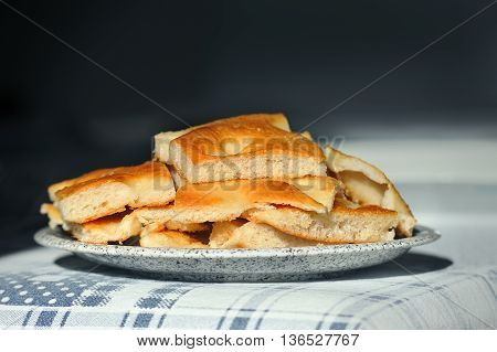 plate of slices Foccacia Italian bread on the table