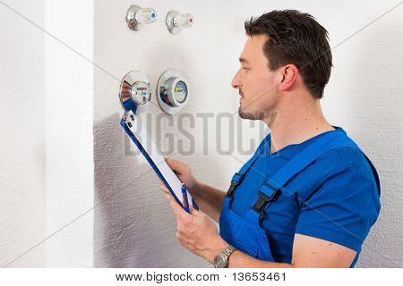 Technician reading the water meter to check consumption