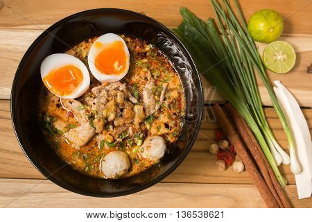 Bowl Of Noodles With Vegetables And Soft Boiled Egg On Wooden Table. Delicious Noodle. Instant Noodl