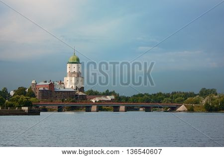 Vyborg castle and Olaf's tower, Petrovsky bridge. View from the North harbor. It's sunny summer.