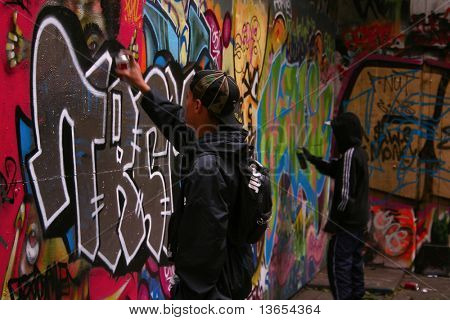 Two Unidentified youths Spray Graffiti in a Dark Alleyway