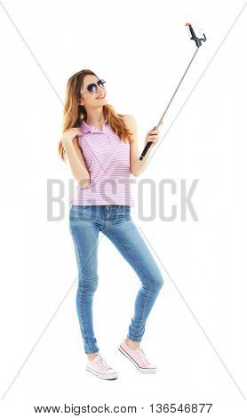 Young attractive woman taking selfie isolated on white