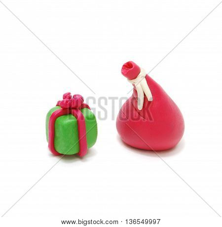 3D Christmas Gift and Red Santa's Sack Made of Plasticine Isolated on White Background