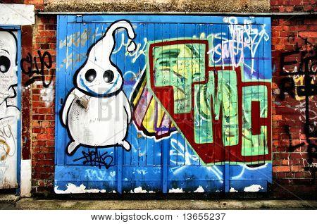 A ghost graffiti tag on a brick wall