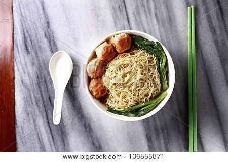 Traditional Chinese bowl of wanton noodle on the table