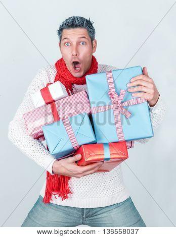 surprising winter man holding many presents