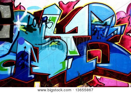 Colorful and abstract graffiti on concrete urban area