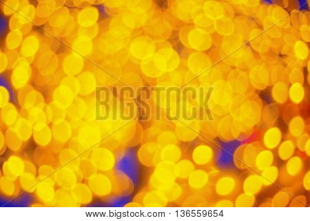 Gold glittering christmas lights. Blurred abstract background.