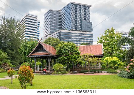 Bangkok Thailand - June 10 2016: Lumpini park with H.M.Queen Sirikit Building in Chulalongkorn hospital background.