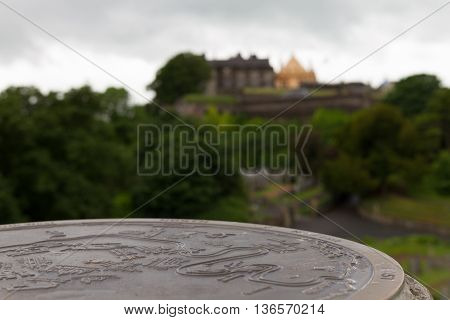 Map of Stirling Old Town Scotland on stone with Stirling Castle in the background.
