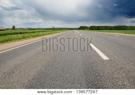 nonurban asphalt road under the cloudy sky