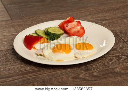 Breakfast set eggs and vegetable. Tomato, paprika.