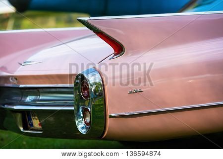 MINSK BELARUS - MAY 07 2016: Close-up photo of pink Cadillac de Ville. Back view of retro car. Selective focus.