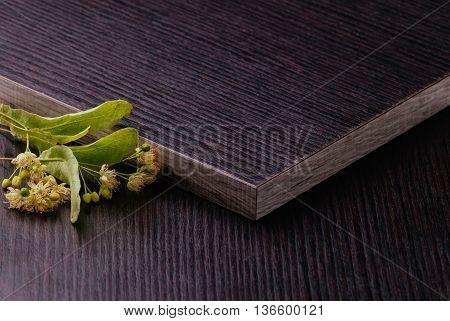 Dark Laminated Chipboard With Linden Flowers