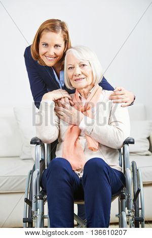 Smiling senior woman with caregiver from nursing service at home