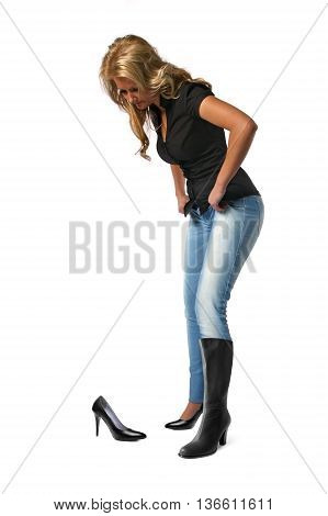Blond woman shopping for new shoes and boots. Isolated on a white background.