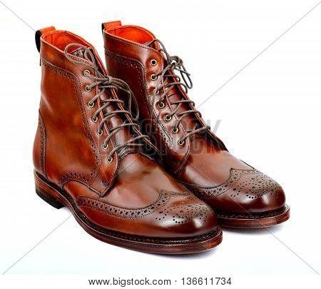 Wingtip dark chili brown dress boots full size isolated on white background