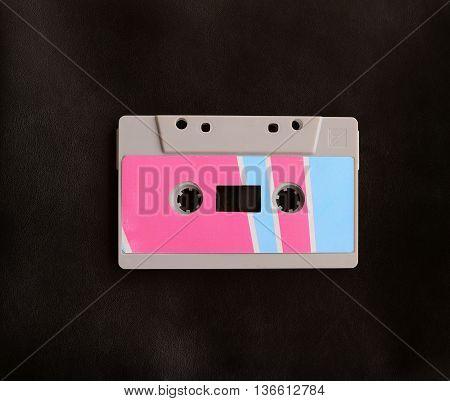 retro style cassete tape on black background