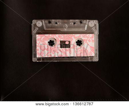 retro pink cassete tape on black background