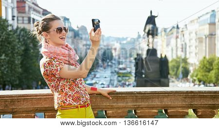 Smiling Woman Taking Photos With Digital Camera In Prague