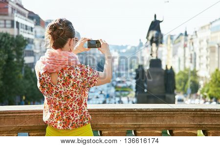 Seen From Behind Woman Taking Photos With Camera In Prague