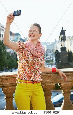 Smiling Woman Taking Photos With Digital Camera In Prague