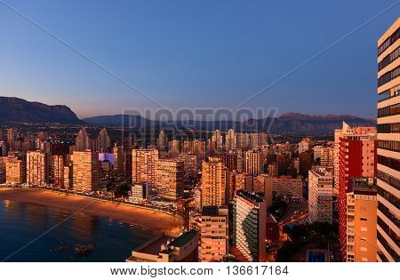 Aerial view of a Benidorm city coastline at sunset. Benidorm is a modern resort city one of the most popular travel destinations in Spain. Costa Blanca Alicante province