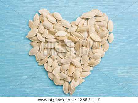 Pumpkin seeds forming a heart. Super food. Clean organic seeds. Fresh fall harvest. Organic seeds.