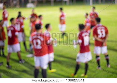 Abstract blur soccer players halftime rest for background
