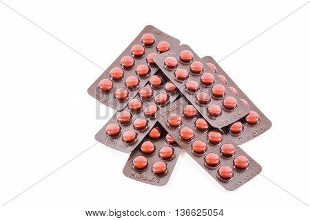 Isolated vitamin B tablet in aluminum foil package
