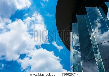 Blue sky and white cloud refection on building