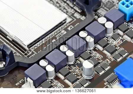 Printed computer motherboard board with microcircuit close-up