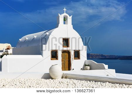 Small traditional Greek Orthodox church in Oia Santorini