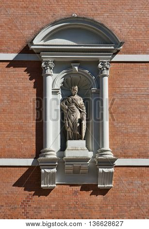 Old statue on a wall on a public building in Flensburg Germany