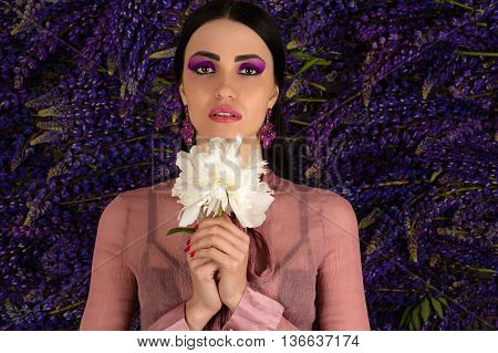 woman with a white peony in hands