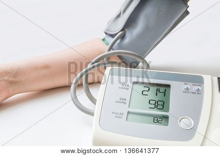 Patient Suffers From Hypertension. Woman Is Measuring Blood Pres