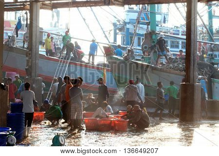 SAMUTSAKORN, THAILAND-SEPTEMBER 17, 2009: Worker is working on fishing boat at Talaythai seafood market, Trading center of fish and seafood products on September 17, 2009 in Samutsakorn, Thailand.