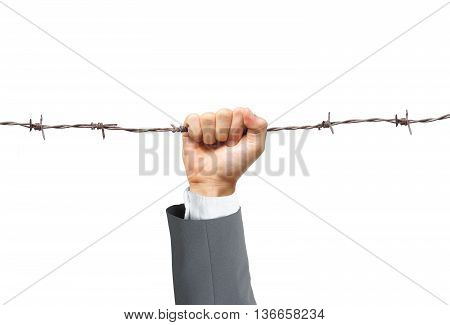 Hand of a businessman holding on a barbed wire - Business risk concept