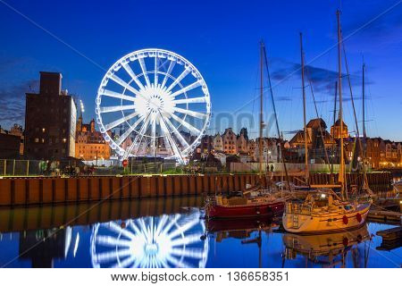 Ferris wheel in the old town of Gdansk at night.