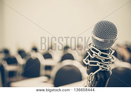 A chained microphone - Freedom of the press is oppressed.
