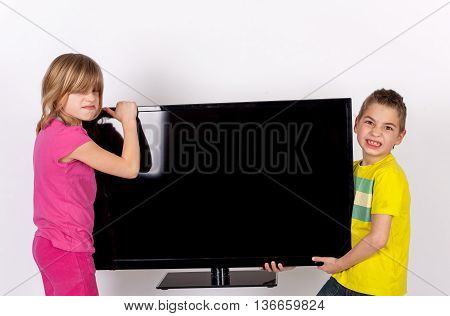 Two cute and funny kids kidnapping the TV