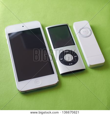BERRY AUSTRALIA - June 23 2016 : Three Apple iPods (left to right) - iPod Touch 5th generation iPod Nano 4th generation and iPod Shuffle 1st generation.