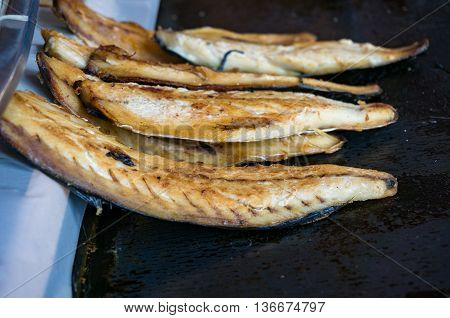 Grilled fish fillets. Traditional Turkish bonito fish snack on street food stall