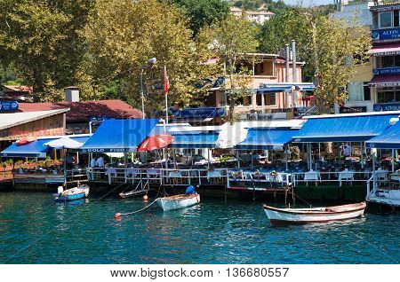 Anadolu Kavagi Turkey - Aug 28 2013: Waterfront restaurants and cafes of a small fishing village Anadolu Kavagi is popular among tourist and locals for Yoros Castle tours