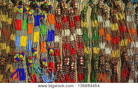 Traditional ethnic African colorful beads necklace. Local craft market in South Africa.