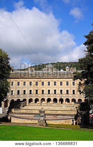 Front view of the Buxton Crescent seen from the slopes memorial gardens Buxton Derbyshire England UK Western Europe.