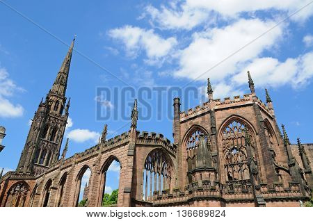 View of the old Cathedral ruin with a statue in the foreground Coventry West Midlands England UK Western Europe.